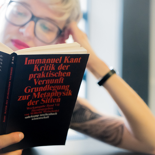 A student reading Kant's Critique of Practical Reason